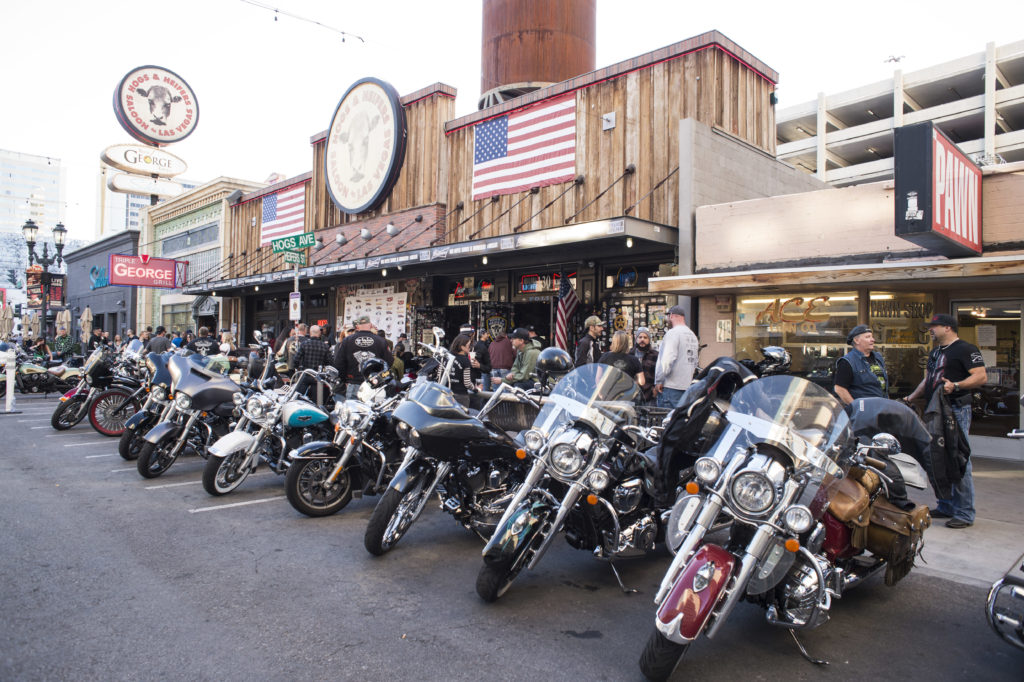 motorcycles in a row parked in front of a Las Vegas Saloon