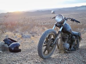 old motorcycle in desert landscape