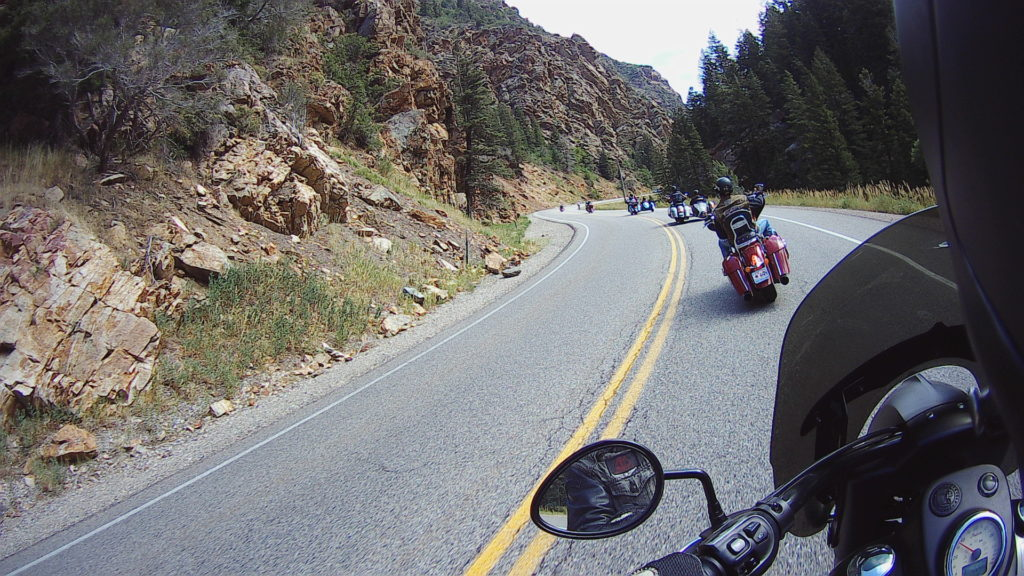 pov of motorcycle cruiser rider following on a mountain road